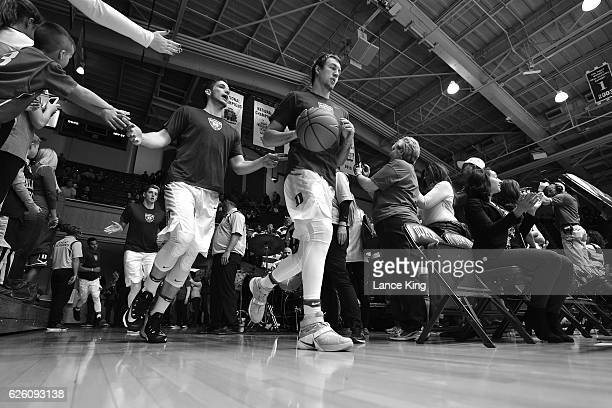 Antonio Vrankovic and Luke Kennard of the Duke Blue Devils run toward the court with teammates prior to their game against the Appalachian State...
