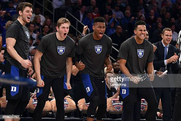 Antonio Vrankovic Jack White Javin DeLaurier and Frank Jackson of the Duke Blue Devils react from their bench during their game against the Kansas...