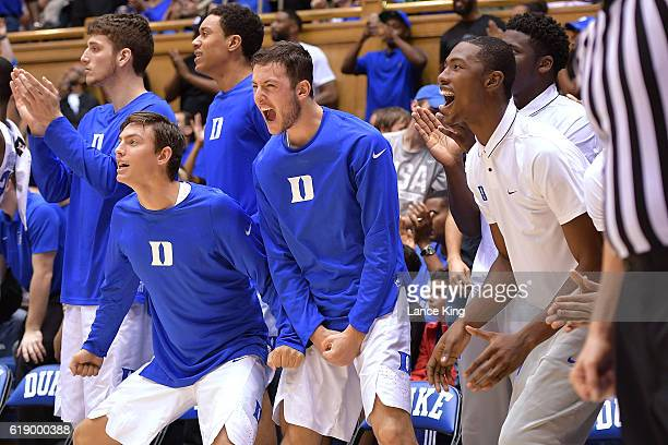 Antonio Vrankovic Nick Pagliuca Justin Robinson Brennan Besser and Harry Giles of the Duke Blue Devils react during their game against the Virginia...
