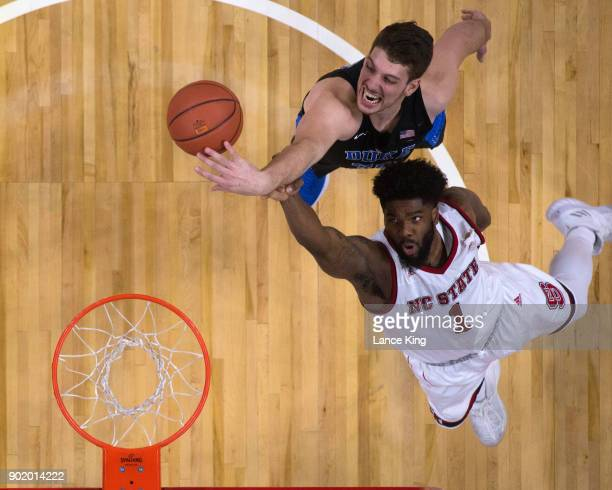 Antonio Vrankovic of the Duke Blue Devils and Lennard Freeman of the North Carolina State Wolfpack battle for a rebound at PNC Arena on January 6...