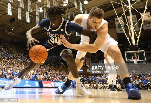 Antonio Vrankovic of the Duke Blue Devils goes after a loose ball against Abdoulaye Gueye of the Georgia Tech Yellow Jackets during their game at...