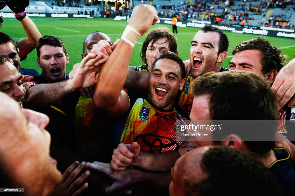 Antonio Winterstein of the Cowboys celebrates after winning the grand final match between the Brisbane Broncos and the north Queensland Cowboys in the Auckland NRL Nines at Eden Park on February 16, 2014 in Auckland, New Zealand.