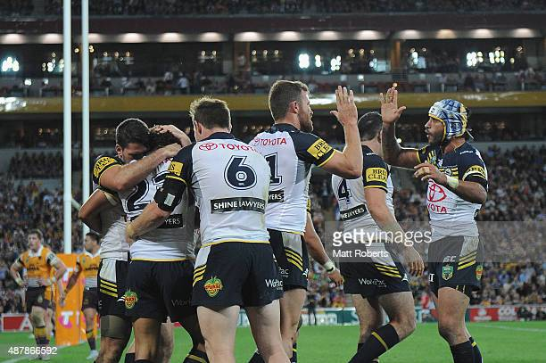 Antonio Winterstein of the Cowboys celebrates scoring a try with team mates during the NRL Qualifying Final match between the Brisbane Broncos and...
