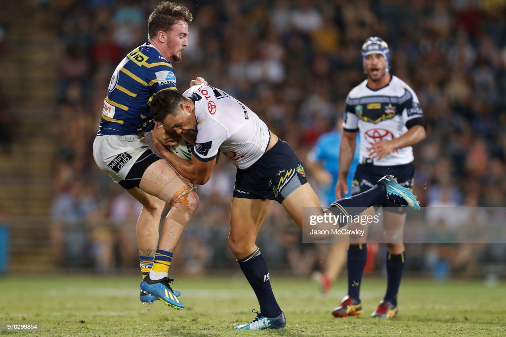 Antonio Winterstein of the Cowboys is tackled by Clint Gutherson of the Eels during the round 14 NRL match between the Parramatta Eels and the North Queensland Cowboys at TIO Stadium on June 9, 2018 in Darwin, Australia.
