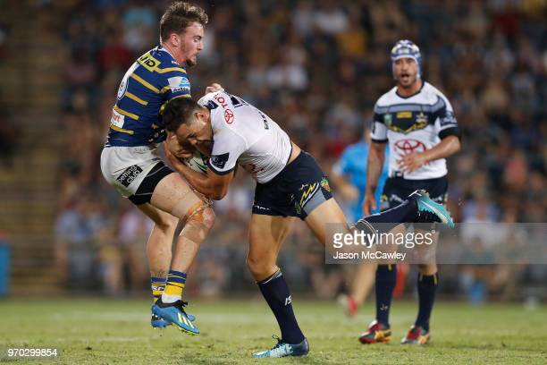 Antonio Winterstein of the Cowboys is tackled by Clint Gutherson of the Eels during the round 14 NRL match between the Parramatta Eels and the North...