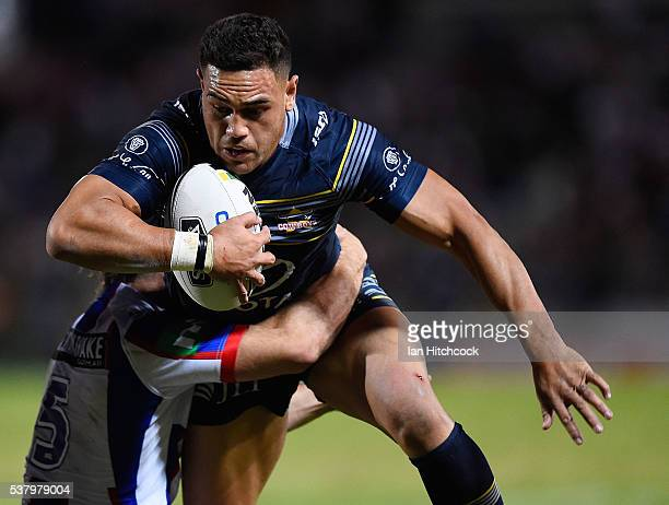 Antonio Winterstein of the Cowboys is tackled by Jake Mamo of the Knights during the round 13 NRL match between the North Queensland Cowboys and the...