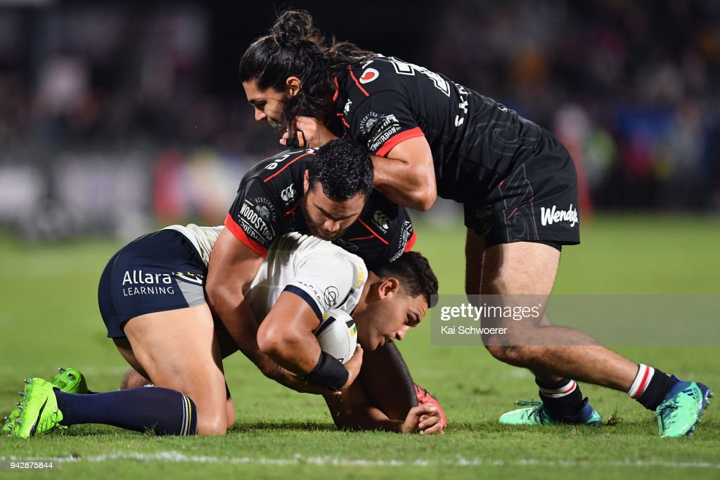 Antonio Winterstein of the Cowboys is tackled by Peta Hiku of the Warriors (C) and Tohu Harris of the Warriors during the round five NRL match between the New Zealand Warriors and the North Queensland Cowboys at Mt Smart Stadium on April 7, 2018 in Auckland, New Zealand.
