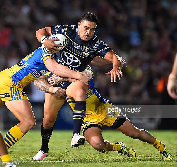 Antonio Winterstein of the Cowboys is wrapped up by the Eels defence during the round eight NRL match between the North Queensland Cowboys and the...