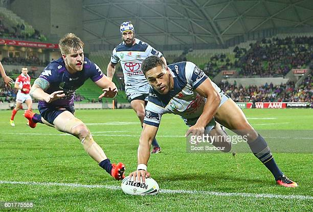 Antonio Winterstein of the Cowboys scores a try as Johnathan Thurston looks on during the NRL Qualifying Final match between the Melbourne Storm and...