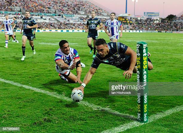 Antonio Winterstein of the Cowboys scores a try during the round 13 NRL match between the North Queensland Cowboys and the Newcastle Knights at...