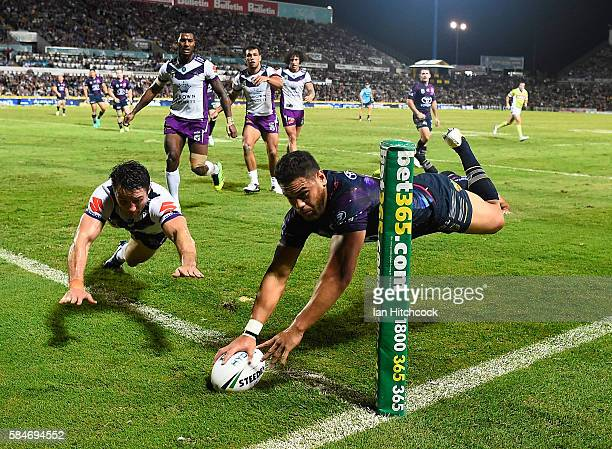 Antonio Winterstein of the Cowboys scores a try during the round 21 NRL match between the North Queensland Cowboys and the Melbourne Storm at...