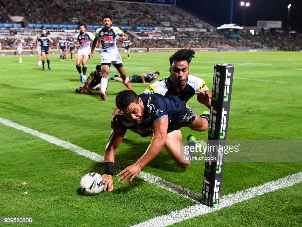 Antonio Winterstein of the Cowboys scores a try during the round four NRL match between the North Queensland Cowboys and the Penrith Panthers at...