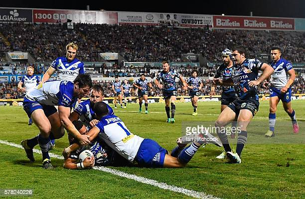 Antonio Winterstein of the Cowboys scores his first try during the round 20 NRL match between the North Queensland Cowboys and the Canterbury...