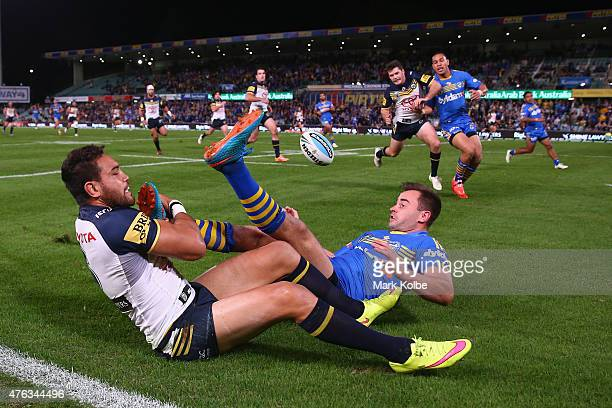 Antonio Winterstein of the Cowboys tackles Ryan Morgan of the Eels during the round 13 NRL match between the Parramatta Eels and the North Queensland...