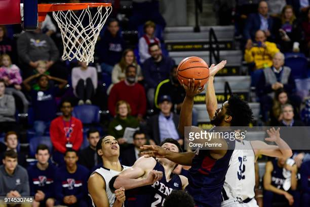 Antonio Woods of the Pennsylvania Quakers drives to the basket against the Yale Bulldogs during the second half at The Palestra on February 3 2018 in...