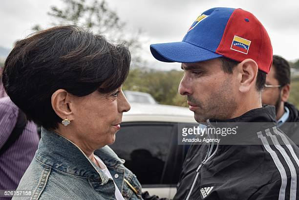 Antonioneta Mendoza mother of jailed opposition leader Leopoldo Lopez hugs Governor of Miranda state Henrique Capriles outside of the military prison...
