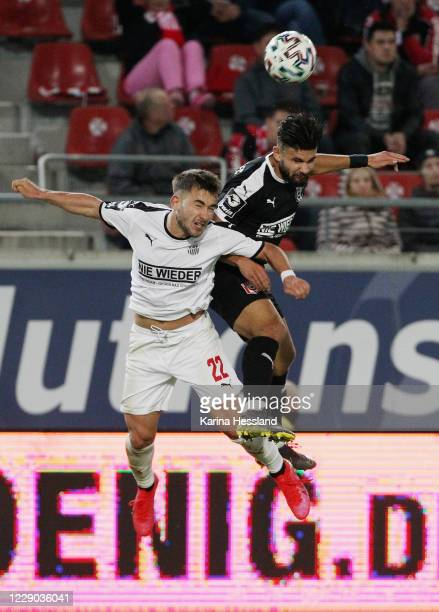 Antonios Papadopoulos of Hallescher challenges Can Coskun of Zwickau during the 3.Liga match between Hallescher FC and FSV Zwickau at Erdgas...