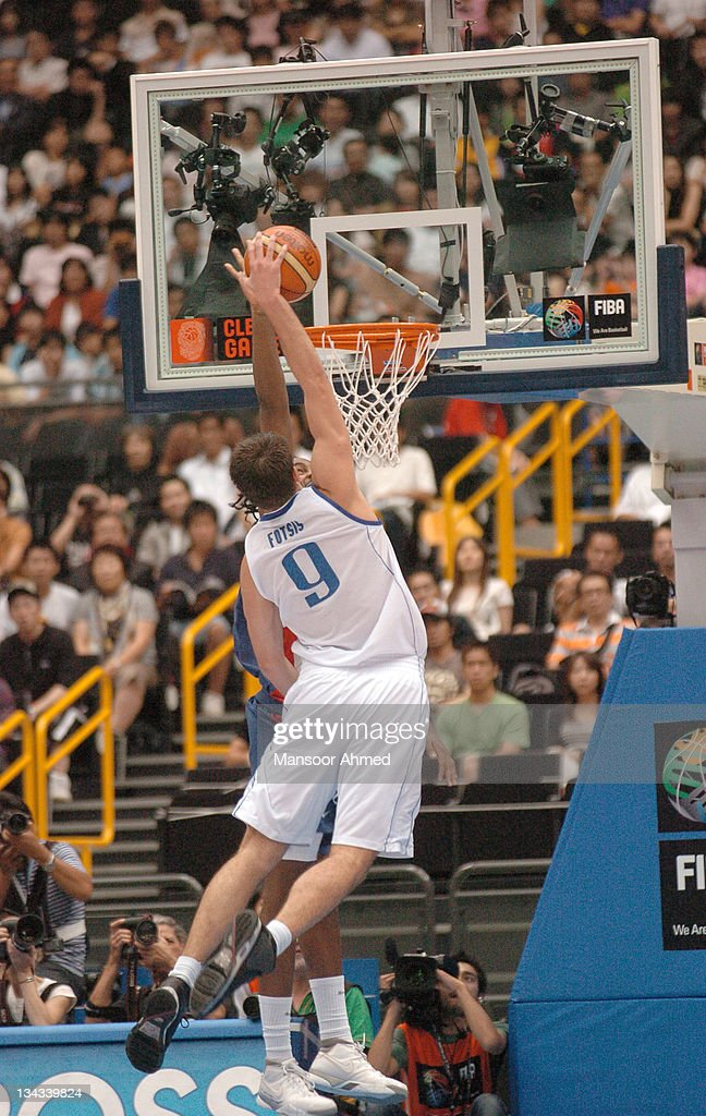 Antonis Fotsis of Greece goes up high for the jam over French player Ronny Turiaf during the FIBA World Championship 2006 quarter final at the Saitama Super Arena, Tokyo, Japan, Wednesday 30th August 2006.