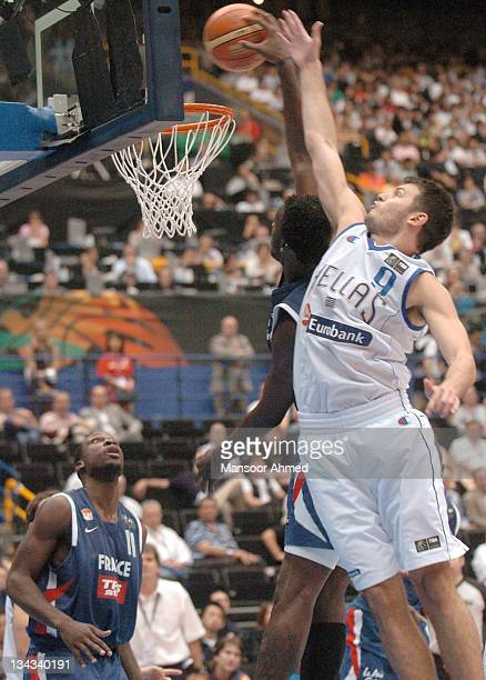 Antonis Fotsis of Greece takes it strong past a French defender during the FIBA World Championship 2006 quarter final at the Saitama Super Arena...