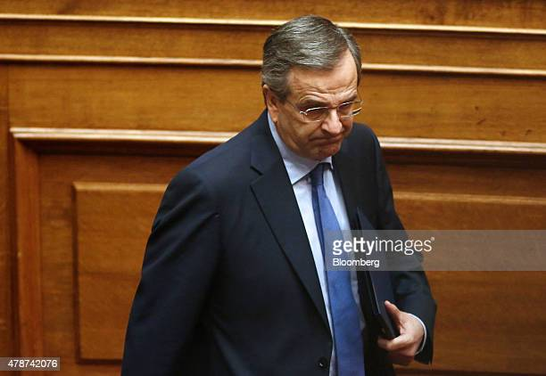 Antonis Samaras Greece's former prime minister arrives to speak to lawmakers inside the Greek parliament in Athens Greece on Saturday June 27 2015...