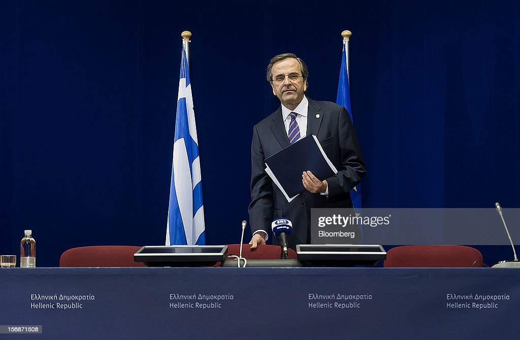 Antonis Samaras, Greece's prime minister, arrives to speak at a news conference following the European Union (EU) leaders summit meeting at the European Council headquarters in Brussels, Belgium, on Friday, Nov. 23, 2012. European Union leaders deadlocked over the bloc's next seven-year budget, adding to the quarrels between rich and poor countries that have stymied the response to the euro debt crisis. Photographer: Jock Fistick/Bloomberg via Getty Images