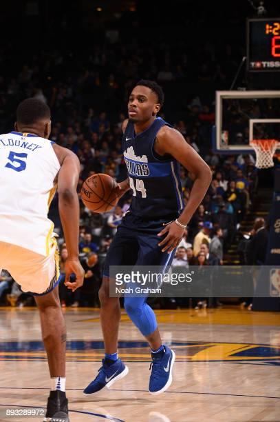 Antonius Cleveland of the Dallas Mavericks handles the ball against the Golden State Warriors on December 14 2017 at ORACLE Arena in Oakland...