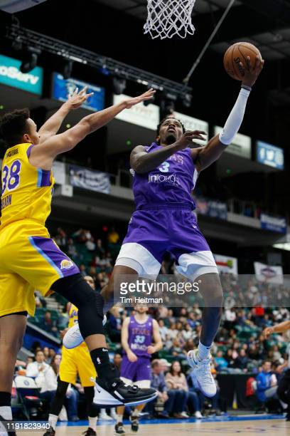 Antonius Cleveland of the Texas Legends drives against Reggie Hearn of the South Bay Lakers in the third quarter on January 04, 2020 at Comerica...