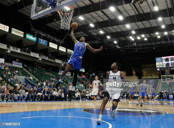 Antonius Cleveland of the Texas Legends dunks the ball against Randy Onwuasor of the Stockton Kings during the fourth quarter on November 20 2019 at...
