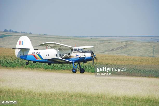 antonov an-2 biplane on the airfield - antonov stock pictures, royalty-free photos & images