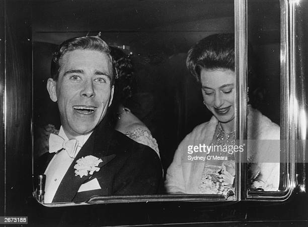Antony Armstrong Jones and Princess Margaret in their car. They are returning to their London home, Clarence House after going to a show.