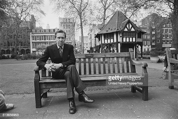 Antony ArmstrongJones Lord Snowdon posed sitting on a bench in Soho Square London on 14th May 1981