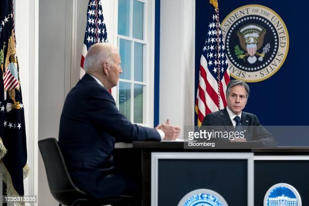 Antony Blinken, U.S. Secretary of state, listens as U.S. President Joe Biden, right, speaks during a Major Economies Forum on Energy and Climate in...