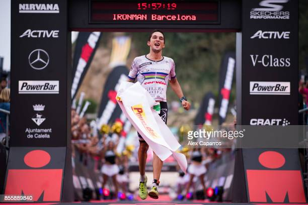 Antony Costes of France celebrates as he crosses the finish line and wins IRONMAN Barcelona on September 30 2017 in Calella Barcelona province Spain