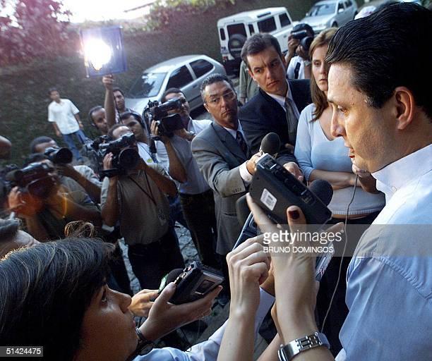 Antony Garotinho speaks to the press outside of his house in Rio de Janeiro 07 October 2002 Garotinho presidential canddiate for Brazil's Socialist...