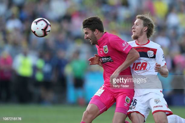 Antony Golec of the Mariners contests the ball with Ben Halloran of Adelaide during the round three A-League match between the Central Coast Mariners...