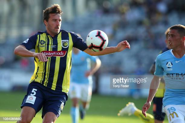 Antony Golec of the Mariners contests the ball with Lachlan Wales of Melbourne during the round two ALeague match between the Central Coast Mariners...