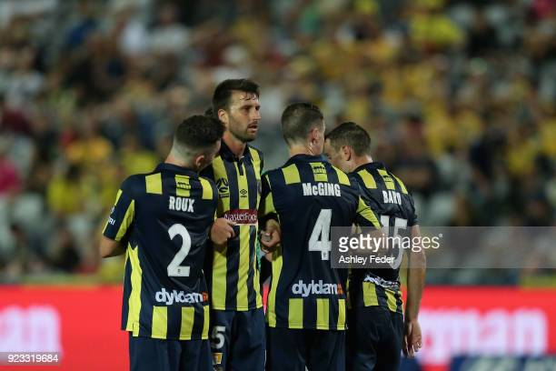 Antony Golec of the Mariners defends a free kick with team mates during the round 21 ALeague match between the Central Coast Mariners and the...