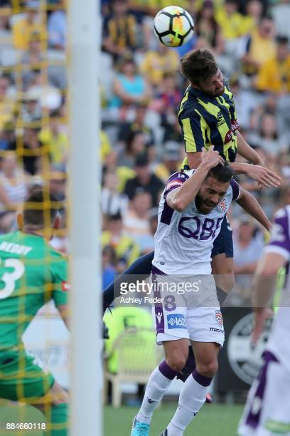 Antony Golec of the Mariners heads the ball during the round nine A-League match between the Central Coast Mariners and Perth Glory at Central Coast...