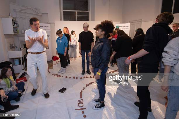 Antony Gormley gives a clay figure making workshop during a free evening for 17-25 years old to view the Anthony Gormley exhibition through BNP...