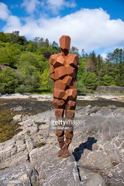 Antony Gormley sculpture GRIP of an abstract human form looking out over Saddell Bay Kilbrannan Sound to Arran in Kintyre Scotlandn
