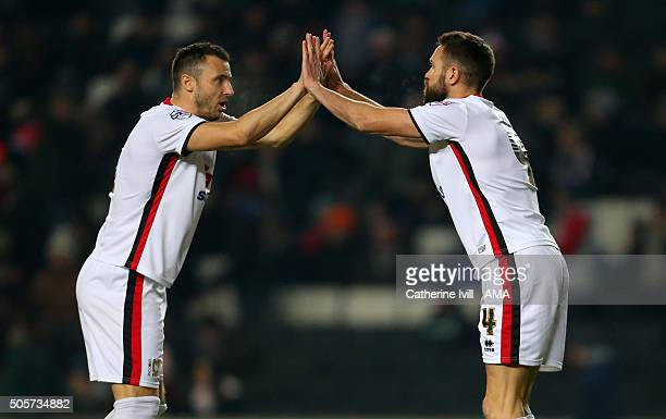Antony Kay of MK Dons and Matthew Upson of MK Dons during the Emirates FA Cup match between MK Dons and Northampton Town at Stadium mk on January 19,...