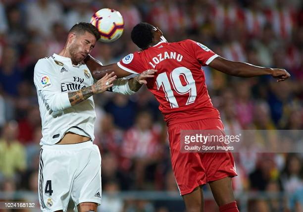 Antony Lozano of Girona competes for the ball with Sergio Ramos of Real Madrid during the La Liga match between Girona FC and Real Madrid CF at...
