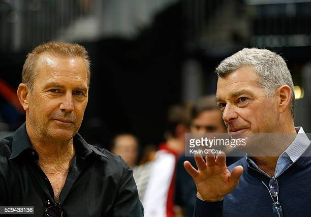 Antony Ressler principal owner of the Atlanta Hawks converses with actor Kevin Costner prior to Game Four of the Eastern Conference Semifinals...