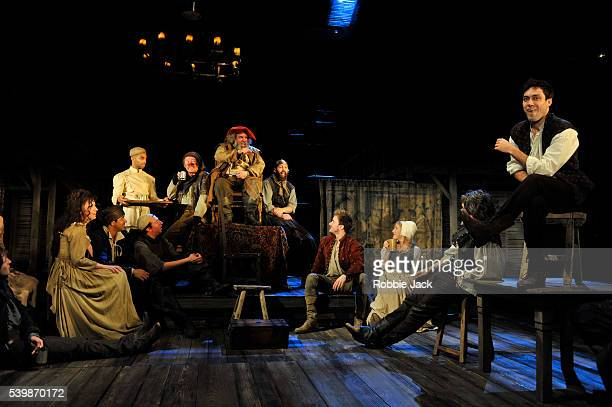 Antony Sher as Sir John Falstaff and Alex Hassell as Prince Hal with artists of the company in the Royal Shakespeare Company's production of William...