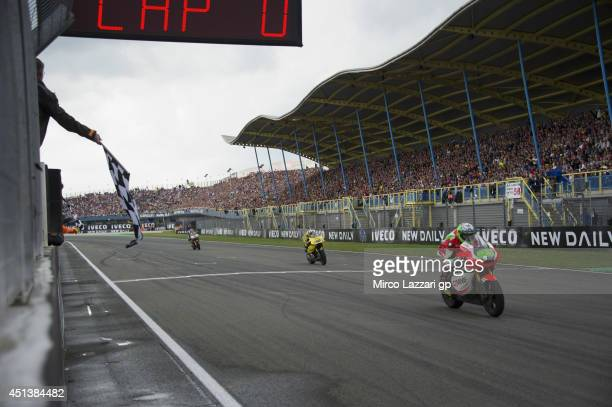 Antony West of Australia and QMMF Racing Team cuts the finish lane and celebrates the victory at the end of the Moto2 race during the MotoGP of...