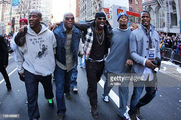Antrel Rolle of the New York Giants and other members of the Giants defensive backfield walk during the New York Giants ticker tape victory parade...