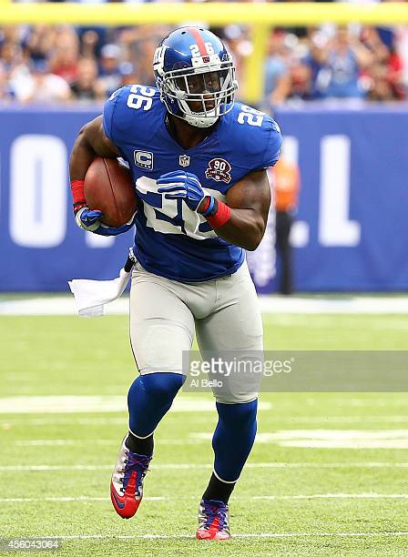 Antrel Rolle of the New York Giants carries the ball against the Houston Texans at MetLife Stadium on September 21, 2014 in East Rutherford, New...