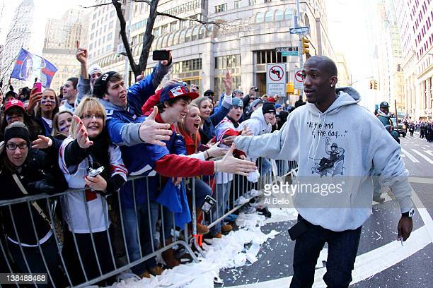 Antrel Rolle of the New York Giants celebrates with fans during the New York Giants ticker tape victory parade down the Canyon of Heros on February...