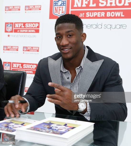 """Antrel Rolle signs copies of Charles Fazzino's """"Super Bowl XLVIII - NY/NJ"""" Poster at Macy's Herald Square on January 30, 2014 in New York City."""