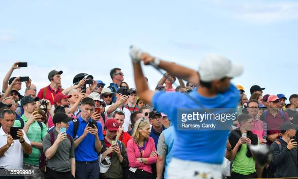 Antrim United Kingdom 16 July 2019 Spectators watch a tee shot by Rory McIlroy of Northern Ireland during a practice round ahead of the 148th Open...
